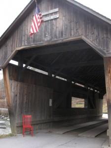 Red Chair at Warren Vermont covered bridge