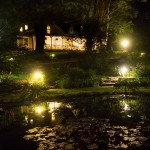 West Hill House B&B at night in summer - by Dave Trainer