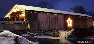 covered bridge lit with a large star