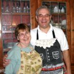 Vermont Innkeepers Peter & Susan MacLaren of West Hill House B&B in aprons