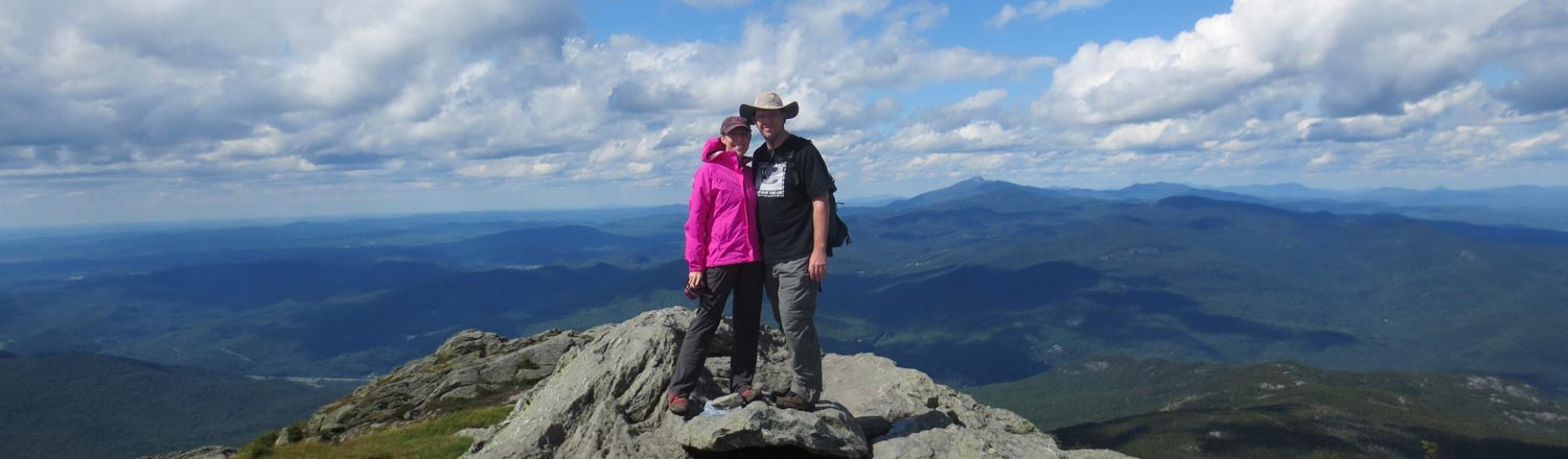 Couple on the top of Camel's Hump in Vermont