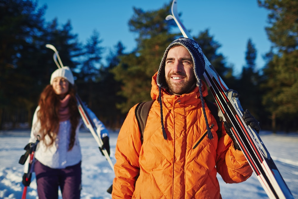 Young Couple getting ready to go cross country skiing at Blueberry Lake Near our Vermont Bed and Breakfast
