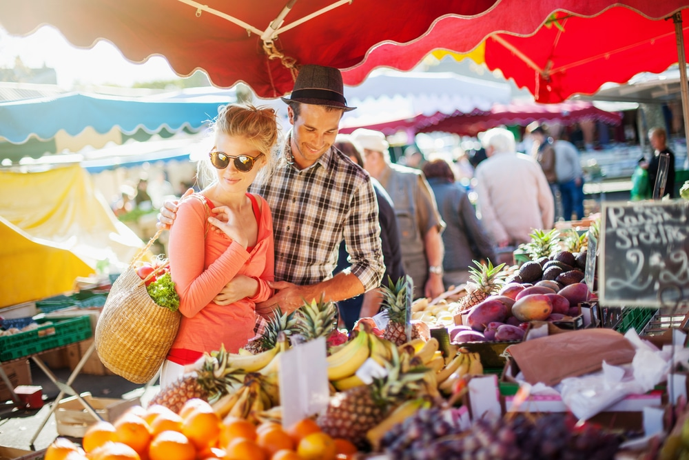 a young couple browsing markets like the Waitsfield Farmers Market in Vermont